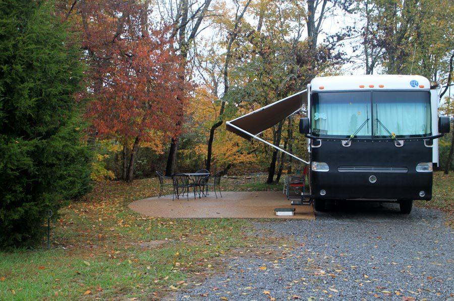 camper-beside-concrete-patio