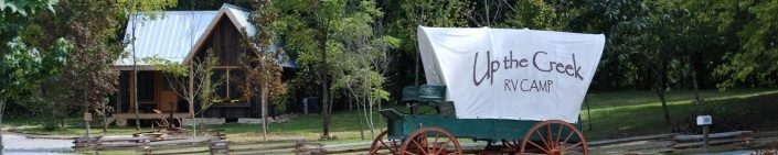 Covered Wagon At Up The Creek Campsite Entrance