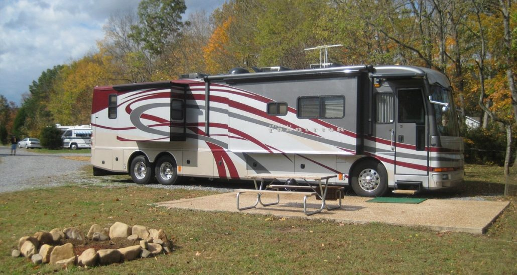 RV Parked At An Up The Creek Site By A Firepit